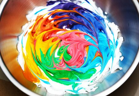 slime ingredients in mixing container wiht colorful result Stock fotó
