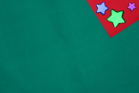 red blue green star on red and green background with copy space for new year and christmas time