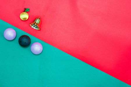 Christmas baubles and bell on Red green background,top  view with copy space