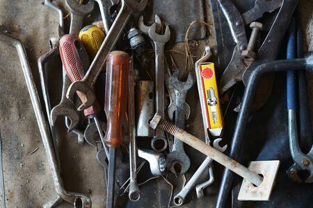 pile of mechanical tools for fix in home ,old fashion ,top view
