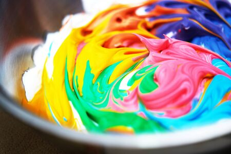 slime ingredients in mixing container wiht colorful result ,colsed up,side view Stock fotó