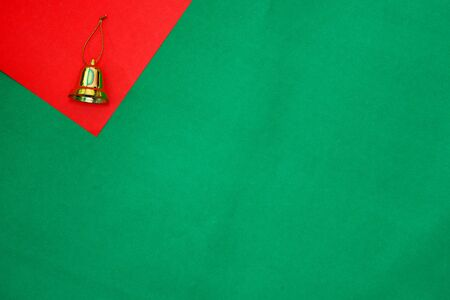 golden ring on red and green background with copy space for new year and christmas time Stock fotó