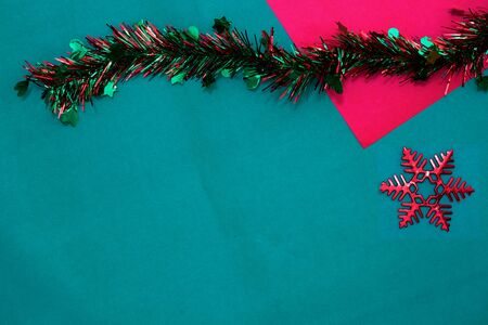 new year Tassel with red snow flake on red and green background with copy space for christmas
