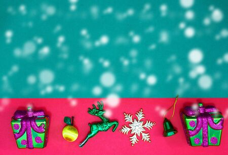 Christmas two present,reindeer snowflake fruits and bell on Red green background and copy space,top  view with snow fall Stock fotó