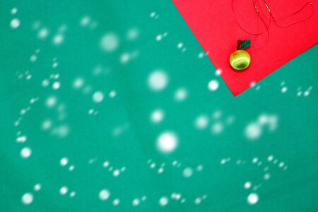 yellow fruit on red and green background with copy space for new year and christmas time with snow fall