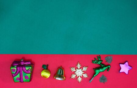 Christmas present,reindeer snowflake fruits and bell on Red green background and copy space,top  view