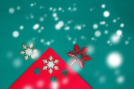 Christmas snow flake and leaves on Red green background,top  view and copy space with snow fall Stock fotó