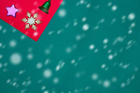 Green bell ,snow flake and star on red and green background with copy space for new year and christmas time with snow fall
