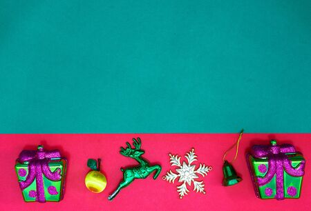 Christmas two present,reindeer snowflake fruits and bell on Red green background and copy space,top  view Stock fotó