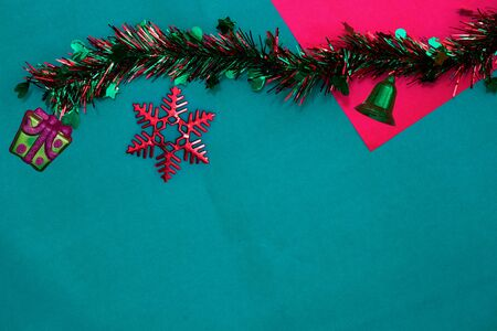 new year Tassel and present ,bell with red snow flake on red and green background with copy space for christmas