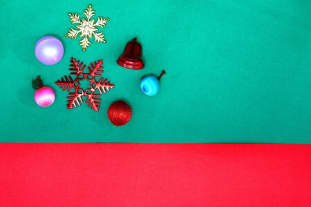 Christmas bauble, snowflake fruits and ring bell on Red green backgroundl,top view with copy space Stock fotó