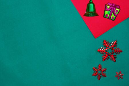 Green bell ,snow flakes and star on red and green background with copy space for new year and christmas time Stock fotó