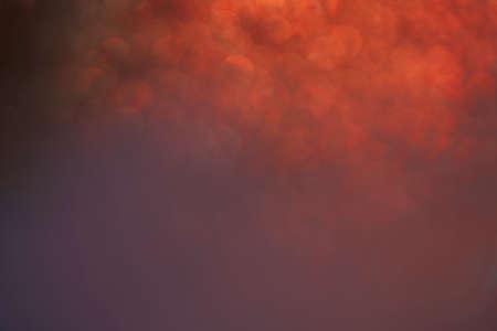 Abstract photo of red smoke  bokeh light on backdrop