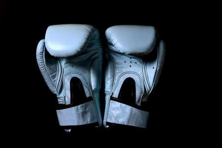 Boxing glove on black background