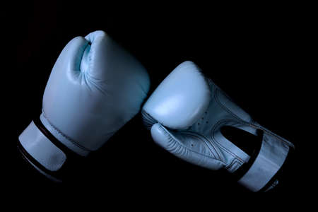 Boxing glove in blue  in black background
