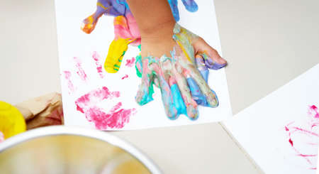 Colorful hand print on canvas with fun art work
