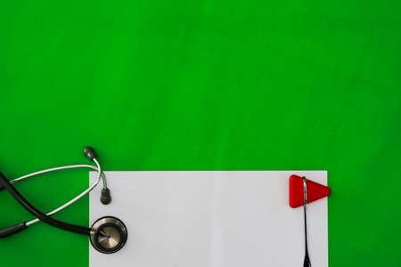 Mock up and doctor jerk hammer,stethoscope on green surgery background in diagnosis and treatment medical healthcare concept with copy space Reklamní fotografie