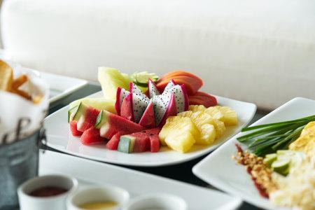 dragon fruit,pine apple,melon,water melon,papaya in plate for snack dessert mixed fruit serve Reklamní fotografie