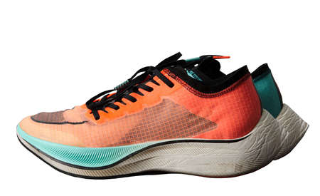 green and orange running shoes on isolated white background,closed up ,side view