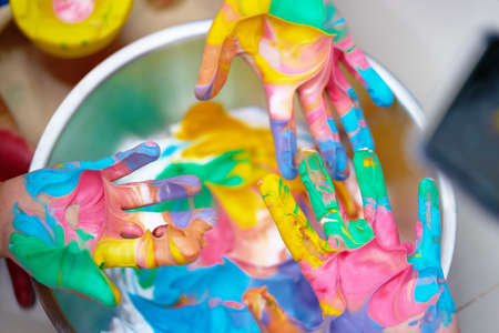 Hands sitick by slime paint in activitiy kid family school learning
