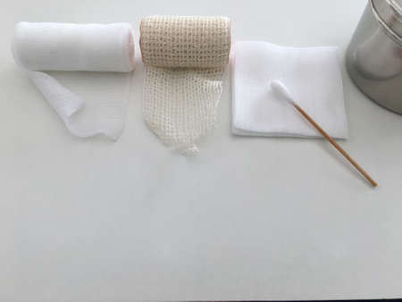 gauze ,roll gauze ,roll bandage ,swab and jar in dressing medical healthcare wound concept with copy space