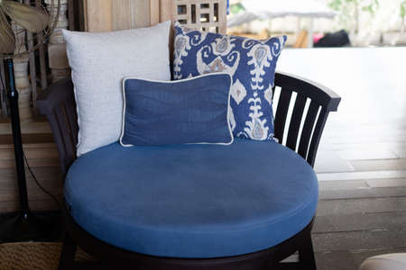Blue vintage style armchair in reception with pillow