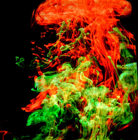 Motion ink Color drop in water make Cloud of ink under water in dark