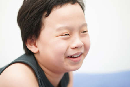 Asia boy child face smile and laugh look away camera head shot portrait with copy space Banque d'images