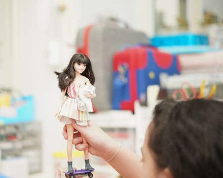 Bangkok,Thailand,Aug 5,2021-girl play Barbie doll on table
