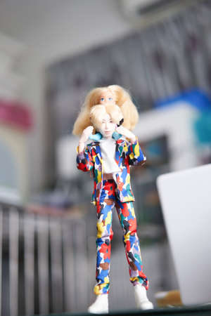 Bangkok,Thailand,Aug 10,2021-Barbie doll child and young man dad hold daughter in his neck blur background