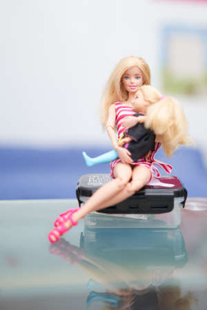 Bangkok,Thailand,Aug 10,2021- Barbie dolls mom and little daughter hold in hug sit on table