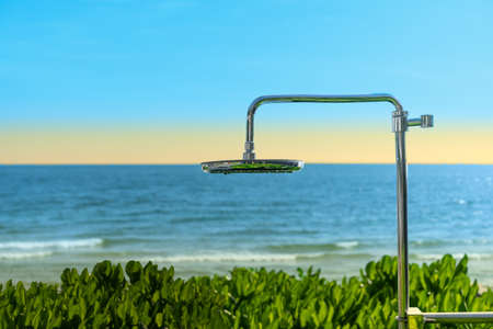 Shower for bathing on the beach and greenery by the sea. twilight sunlight sunset