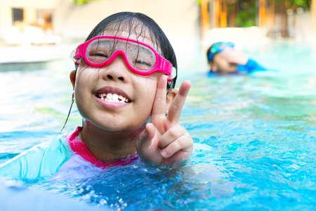 kids in goggles in swimming pool