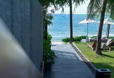 walk way to beach front in hotel and sky