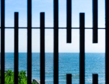 grating beach window view ocean sea and sand
