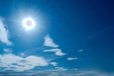 solar eclipse: Solar Eclipse in blue sky among the clouds