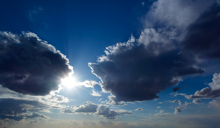 Sun and clouds on a blue sky photo