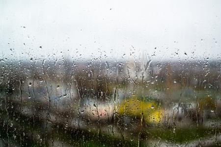 windowpane: rain drops fall on the transparent windowpane Stock Photo