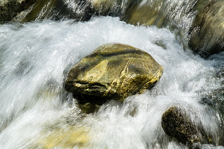 turbulent flows around a mountain stone glittering plastic jets Stock Photo