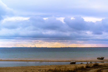 Coast of the sea, horizon line and storm clouds in the sky