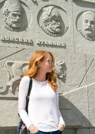 Redhead model near the monument to the Cossacks