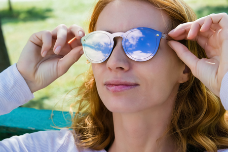 model with the red hair in the sunglasses glasses