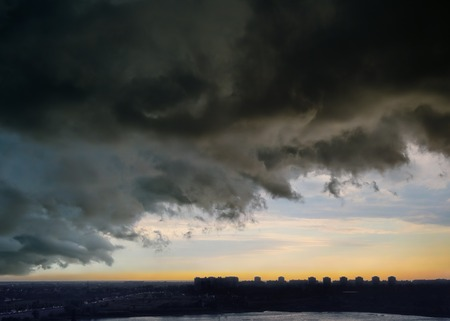 Sky before thunderstorm over the evening city