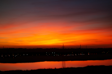 Bloody sunset in scarlet clouds 写真素材