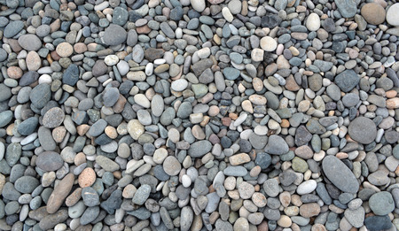 Beach stones background. Top view.