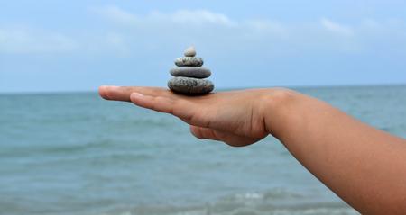 Hand stone sea