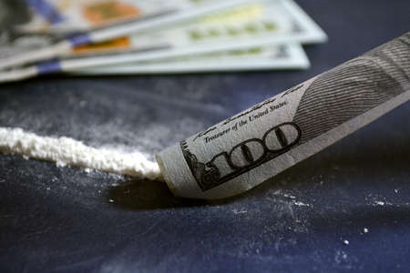 Drugs before use. Cocaine on the table with dollars. Bill tube. Coconut next to dollar bills. Zdjęcie Seryjne