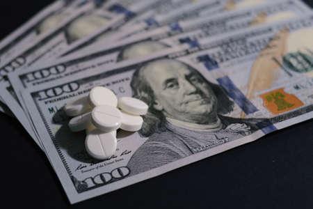 Tablets on 100 dollar banknotes. Pills on 100 dollar banknotes