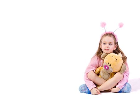 toyshop: young girl with toy on white background