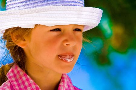 sweetness: small girl with hat and ice cream Stock Photo